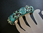 Picture of Brass bracelet from polymer clay and glass.