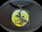 Picture of Marbling Art and glass cabochon.